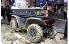 Ein Roboter-Mini-Laster von Honda für schweres Gelände, der selbstständig Transportaufgaben auf unwegsamem Terrain leisten kann.